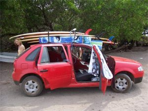 Our Other Friend's Rental Car, Overloaded With Boards